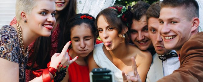 Wedding guests capturing a genuine and fun wedding moment